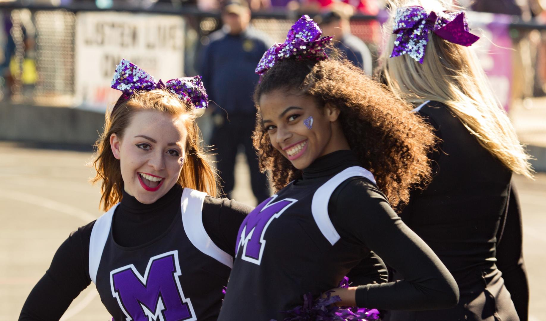 Mount Union cheerleaders on the sidelines during a football game